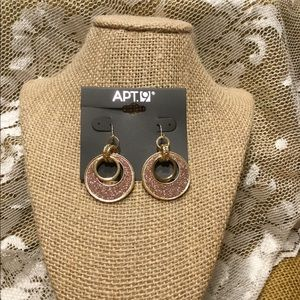 Gold and sparkling dangle earrings.